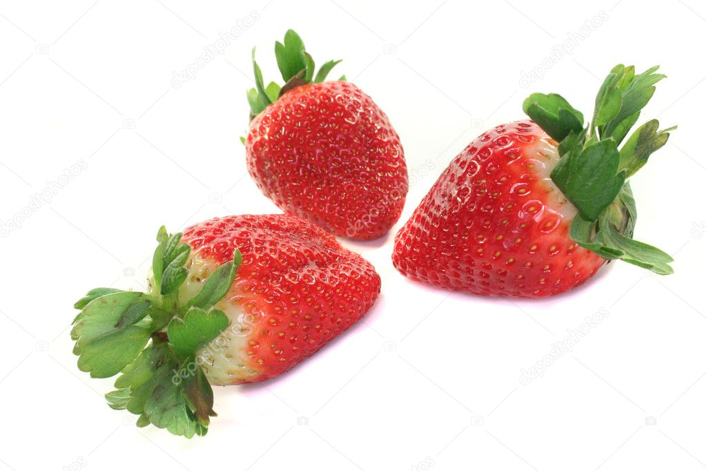 Three strawberries on a white background — Stock Photo #2419865