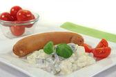 Bockwurst with potato salad — Stock Photo