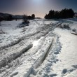 Winter snow road with sunshine star. — Stock Photo