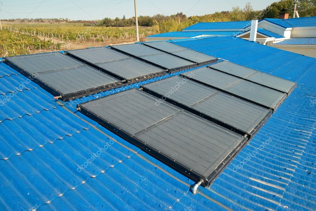 Solar water heating system on the house roof. — Stock Photo #1621537