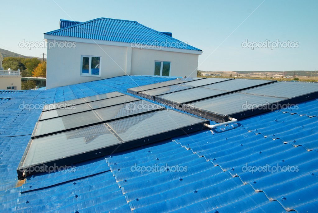 Solar water heating system on the house roof.  Stock Photo #1621567