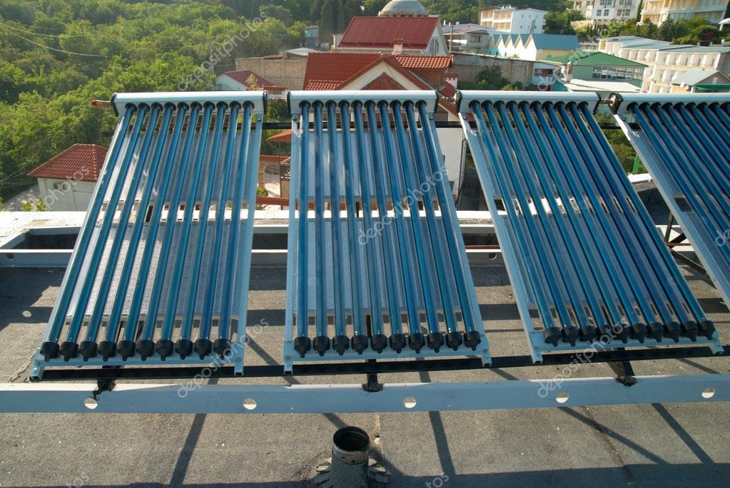 Vacuum solar water heating system on the house roof. — Stock Photo #1621917