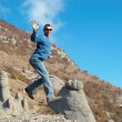 Man jumping on the rocks — Stock Photo #1650073