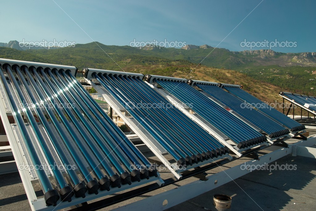 Vacuum solar water heating system on the house roof.  Foto de Stock   #2067255