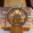 Stock Photo: Old boat steering wheel