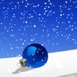 Royalty-Free Stock Vector Image: Christmas ball on the snow