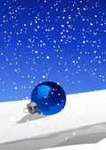 Christmas ball on the snow — Stock Vector