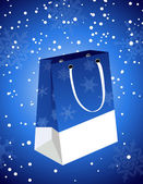 Christmas bag under snowfall — Stock Vector