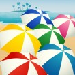 Umbrellas on the beach — Stock Vector