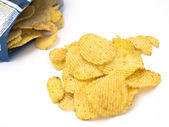 Potato crisps on white — Stock Photo