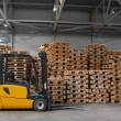 Forklift ready for work in a real warehouse — Stock Photo #1635846