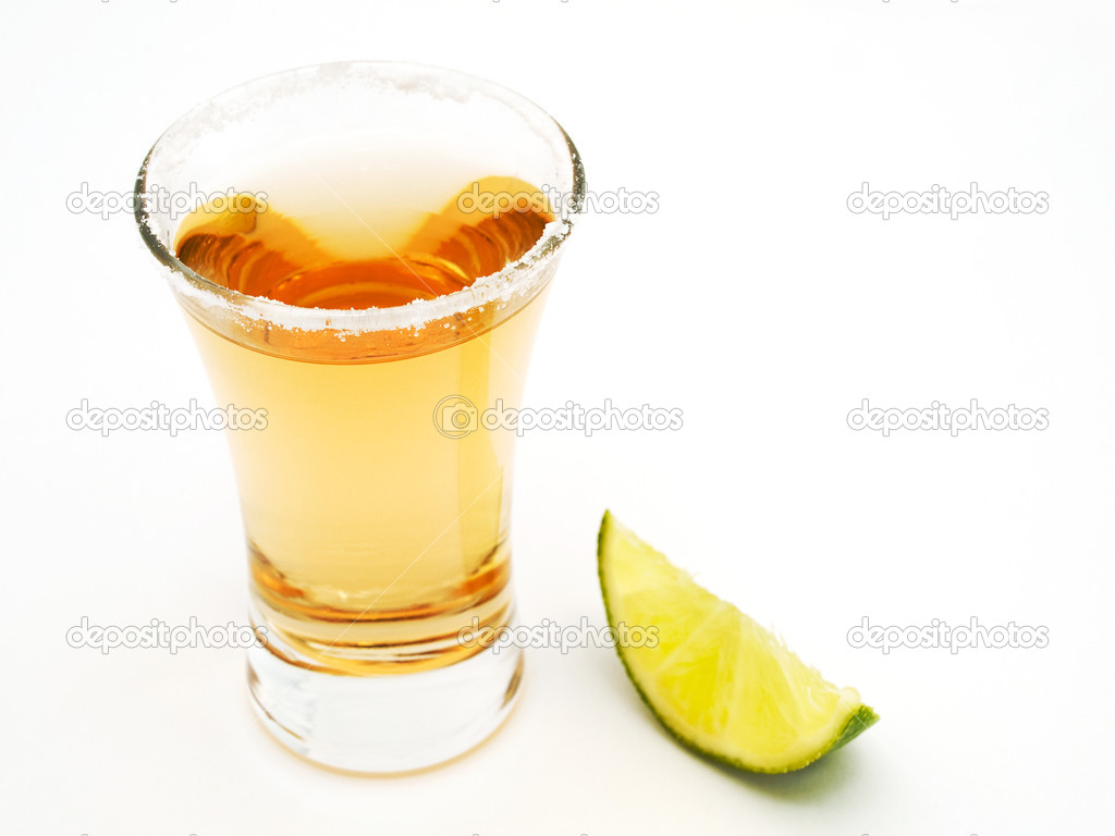 Tequila shot and a piece of lime — Stock Photo #1636039