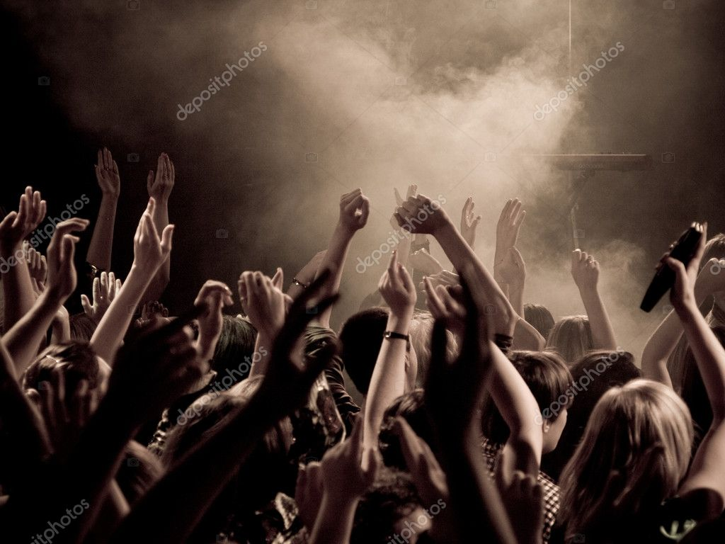 Crowd at a concert with hands up in the air  Stock Photo #1690074