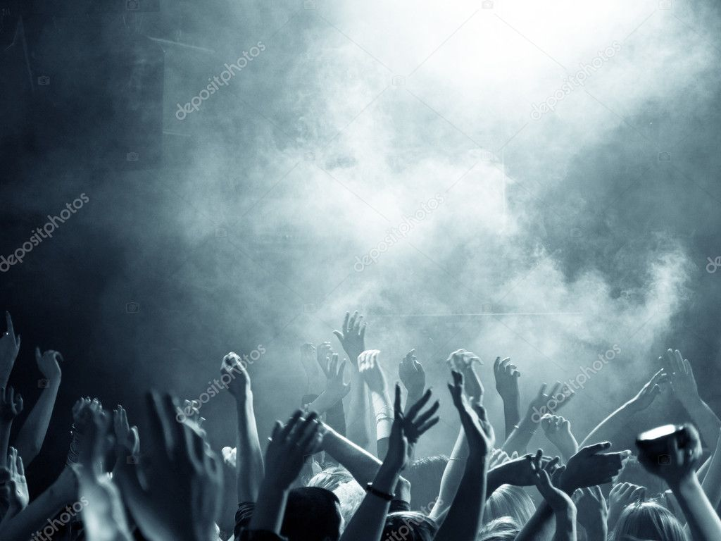Crowd at a concert with hands up in the air — Stock Photo #1690522