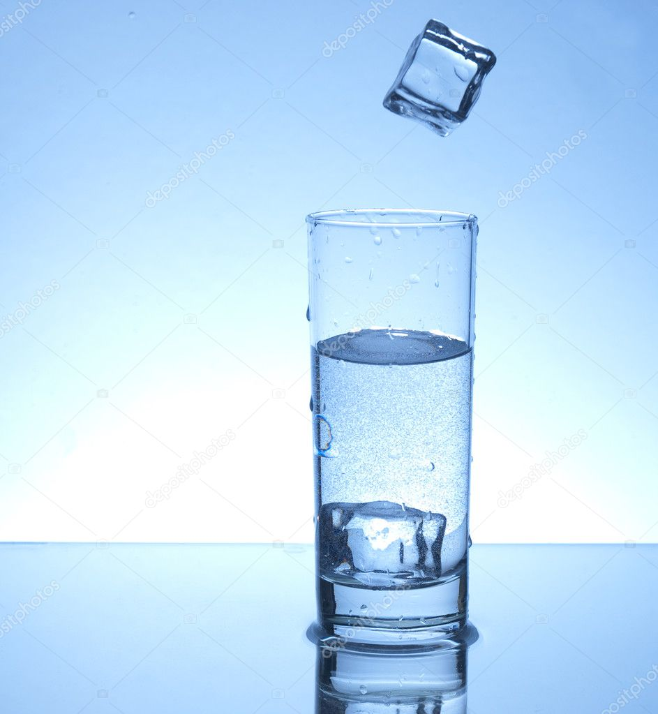 Ice cube falling in a glass of water — Stock Photo #2218111