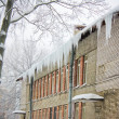 Icicles on the house — Stock Photo