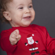 The charming baby on a black background — Stock Photo #1600007