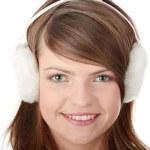 Pretty young teen girl wearing white earmuff — Stock Photo