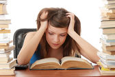 Teenage studying at the desk being tired — Stock Photo