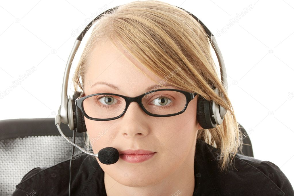 Young beautiful customer service operator girl in headset ,sitting at the desk, isolated on white background. — Stock Photo #1619761