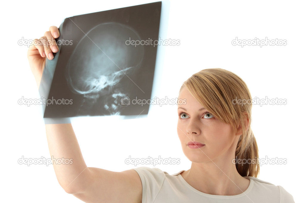Female doctor examining a haed x-ray photo scan. Isolated on white  Stock Photo #1619855