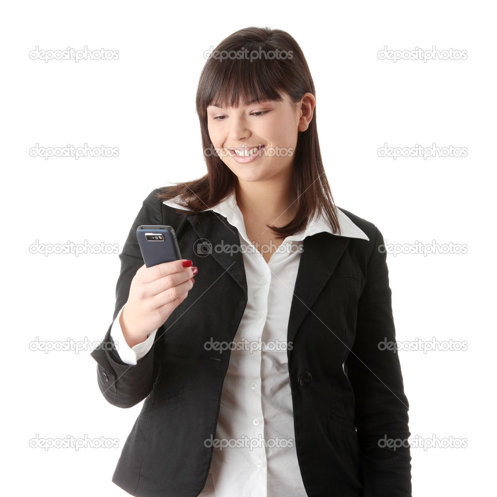 Young businesswoman using cell phone, isolated on white  Stock Photo #1620724