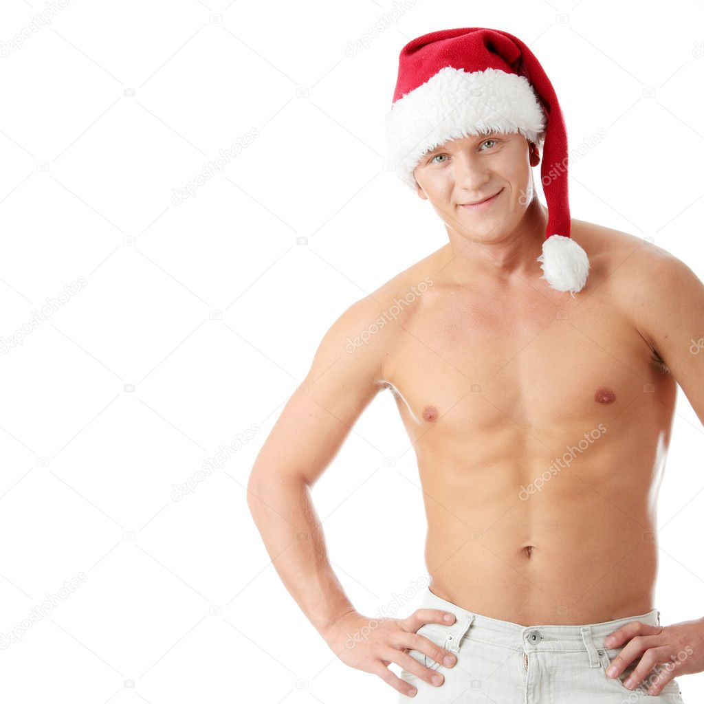 Sexy muscular man wearing a Santa Claus hat isolated on white — Stock Photo #1748968