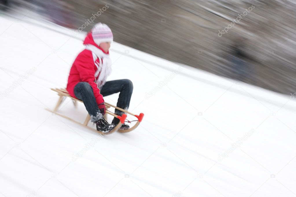 Child in the snow, sledging  and recreation  Stock Photo #1631170