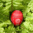 Stock Photo: Easter egg on green