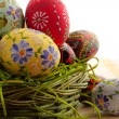 Easter egg in wicker basket — Stock Photo #2063216