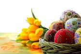 Easter egg in wicker basket — Stock Photo