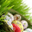 Easter egg in wicker basket — Stock Photo #2561722