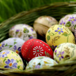 Easter egg in wicker basket — Stock Photo #2561808