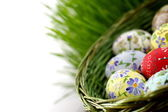 Easter egg in wicker basket — Stock Photo