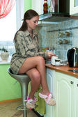 Beautiful girl on a kitchen — Stock Photo