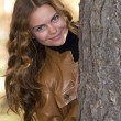 The beautiful girl in park — Stock fotografie