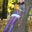Nice girl at a tree — Stockfoto