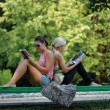 Stock Photo: Two girls on a bench in park
