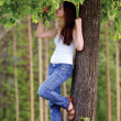 Girl at a tree — Stock Photo