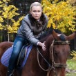 Pretty girl astride a horse — Stock Photo #1746407