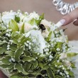 Bumble-bee on the bouquet of bride — Stock Photo