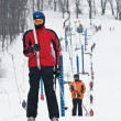 Stock Photo: Skiers on the lift