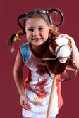 The small amusing girl with a toy — Stock Photo