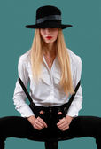 Blonde in a black hat — Stock Photo
