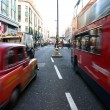 Traffic on Oxford Street in London - Stock Photo