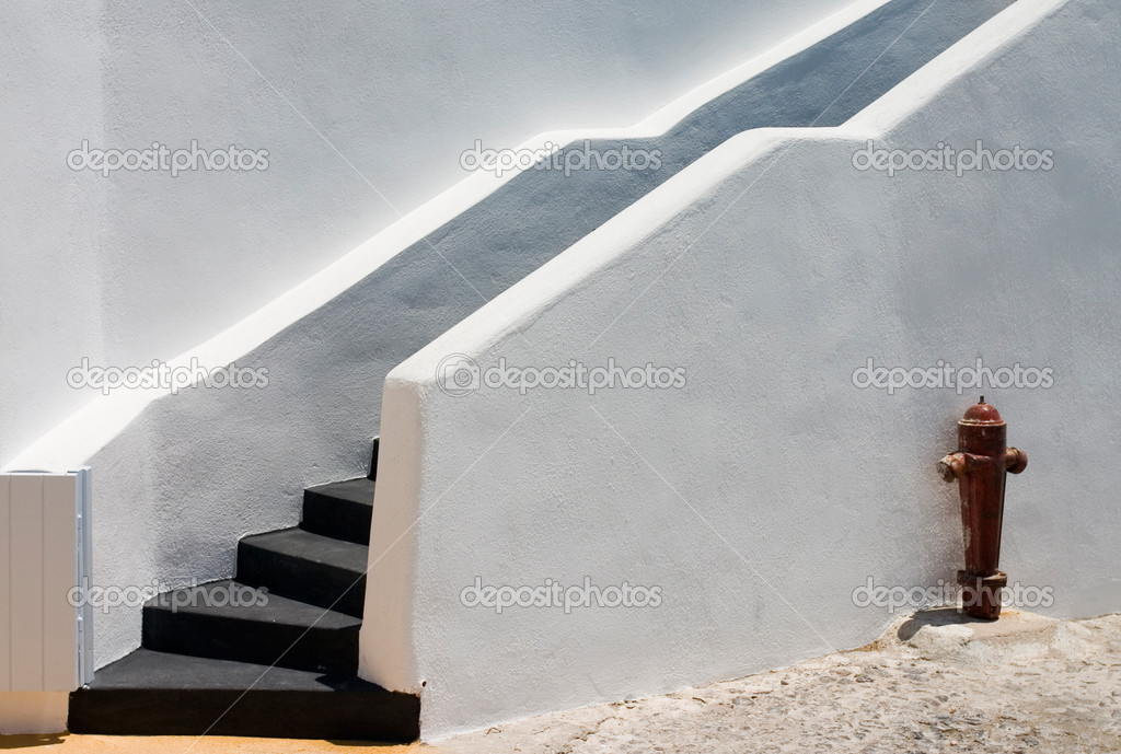 Black stairs on white wall with fire hydrant — Stock Photo #1692635