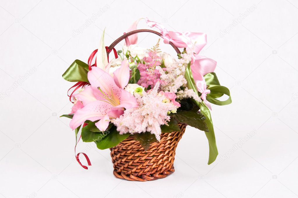 Basket full of variety flowers and green bow  Stock Photo #1704994