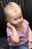 Baby on phone — Stock Photo