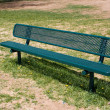 Stock Photo: Deserted park bench