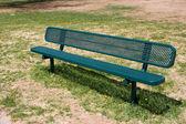 Deserted park bench — Stock Photo